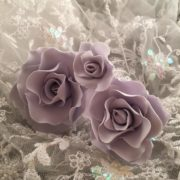 purple roses on lace